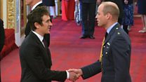 Geraint Thomas receives OBE from Prince William