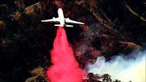 Jets drop flame retardant