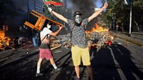 Water cannon and fires amid Chile unrest