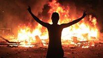 Iraq protesters defy curfew