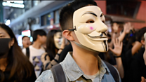 Hong Kong Halloween protesters defy mask ban