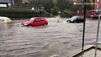 A car driving through flood water