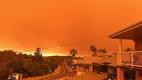 'Unprecedented' bushfires turn skies orange