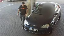 Accused rapist filmed at petrol station with woman