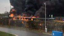 Crews tackle university campus bus blaze