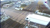 Lorry smashes through level crossing barrier