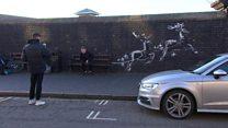 Festive Banksy artwork highlights homeless
