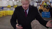 Johnson puts reporter's phone in pocket