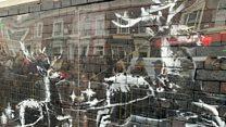 Protection for defaced Banksy artwork