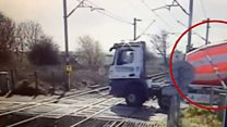 Reversing lorry almost hits train at crossing