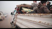 Syrians flee towards Turkey amid Idlib violence