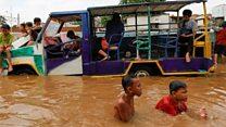 Torrential rain floods Jakarta