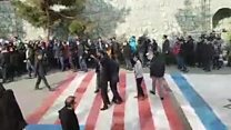 Students refuse to walk over US and Israeli flags