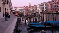 Venice canals left dry by exceptionally low tide