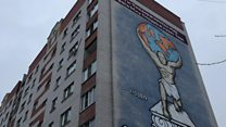 Mural shows Putin as Atlas with globe