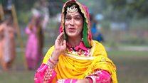 The man acing women's folk dance in India
