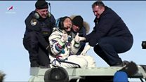 Record-breaking female astronaut returns to Earth