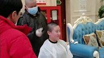Coronavirus medics shave heads