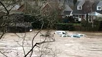 Cars swept away by flood water