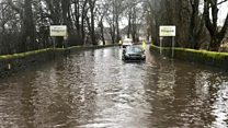 Car stranded in floodwater in Milngavie