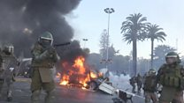 Cars set alight during Chile protest