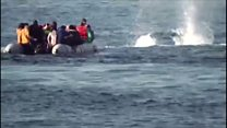 Greek coast guards fire into sea near migrant boat