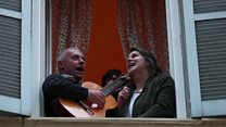 Italians sing from their windows to defy coronavirus