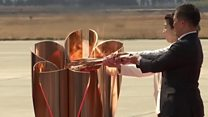Olympic flame lit at empty ceremony in Japan