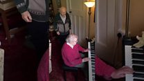 Elderly couple dance and play through isolation