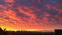 Melbourne celebrates vivid sunrise 'amid the chaos'