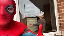 Spider-man jogger cheers up children