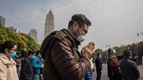 China stops for three minutes to remember the dead