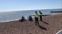 Police speak to people having beach bbq