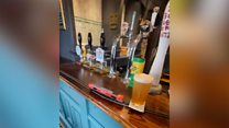 Locked-down pub manager serves beer on model train