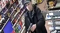Police praise shopkeeper who chased 'armed' robber