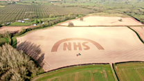 Farmer ploughs NHS sign into field