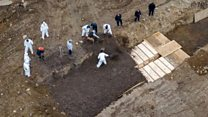 Drone footage shows mass burials in New York