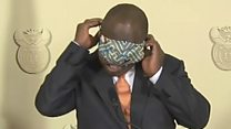 South African president's face mask struggle