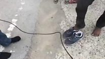 Reporter's gift of shoes to migrant goes viral