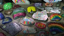 Painted pebbles made into lasting NHS memorial