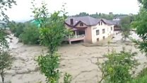 Ukraine floods wash away homes and roads