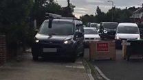 Cars mount pavement to avoid blockade