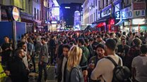 Packed streets as Soho pubs reopen