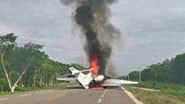 'Drug plane' lands on road and bursts into flames