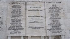 A carved stone tablet at the Berlin stadium lists 1936 medal winners - there remains a dispute over marathon winner Son Ki Jung