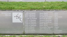 The wall listing the 1972 Olympic winners in each event