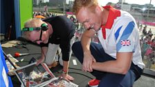 Greg Rutherford checks out the papers with Chris Evans