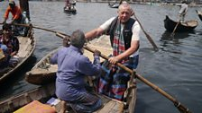 Mr Loteef, 70, is a ferryman on the Buriganga River, Dhaka. He is training Colin from Canvey Island the art of rowing his boat.