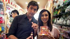 Justin Rowlatt and Anita Rani buy lucky charms for their cars in Tianyi market, Beijing.