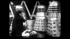 The Doctor and Waterfield Surrounded by Daleks
